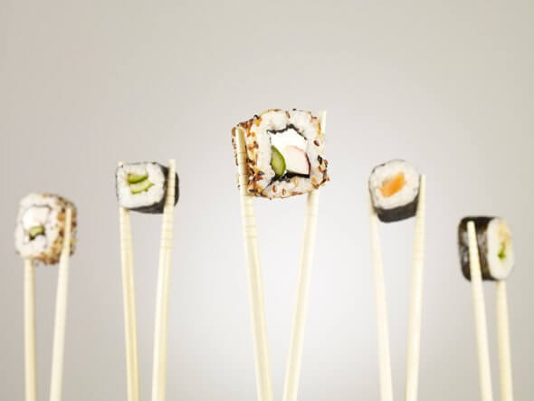 sushi-held-by-chopsticks {focus_keyword} Sushi: Makanan Sihat @ Tak Sihat? sushi held by chopsticks